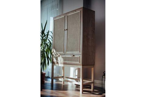 Minimalist Jute Cabinet With Jute Doors And Wooden Legs